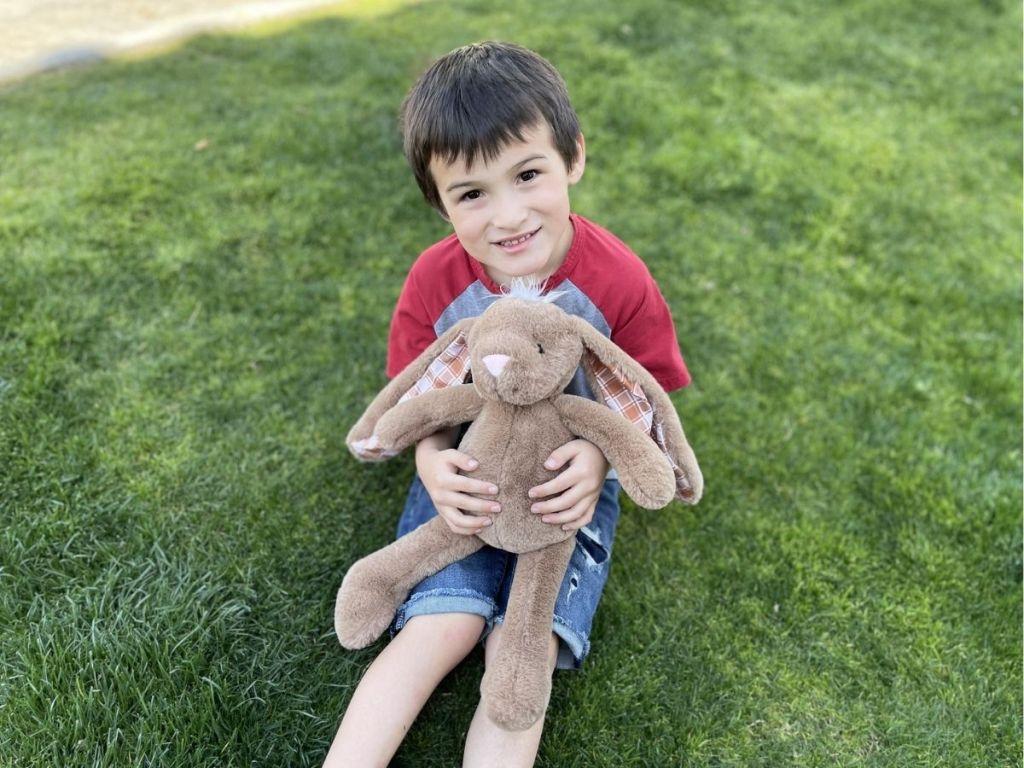 boy holding tan Easter bunny