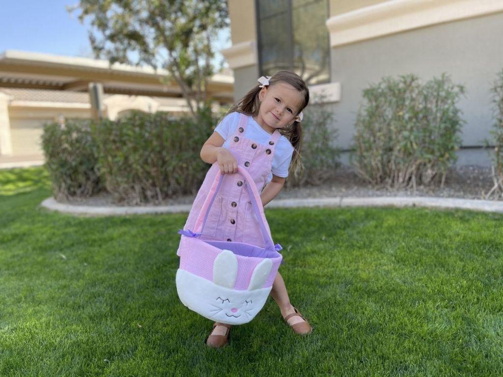 girl holding Easter bunny basket