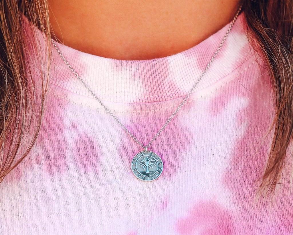 pura vida necklace on tie dye shirt