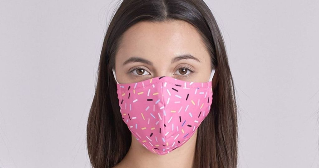 woman wearing pink donut sprinkles mask