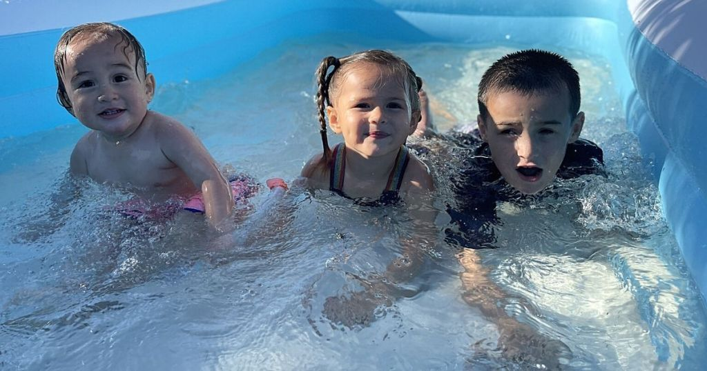 kids in sable inflatable pool
