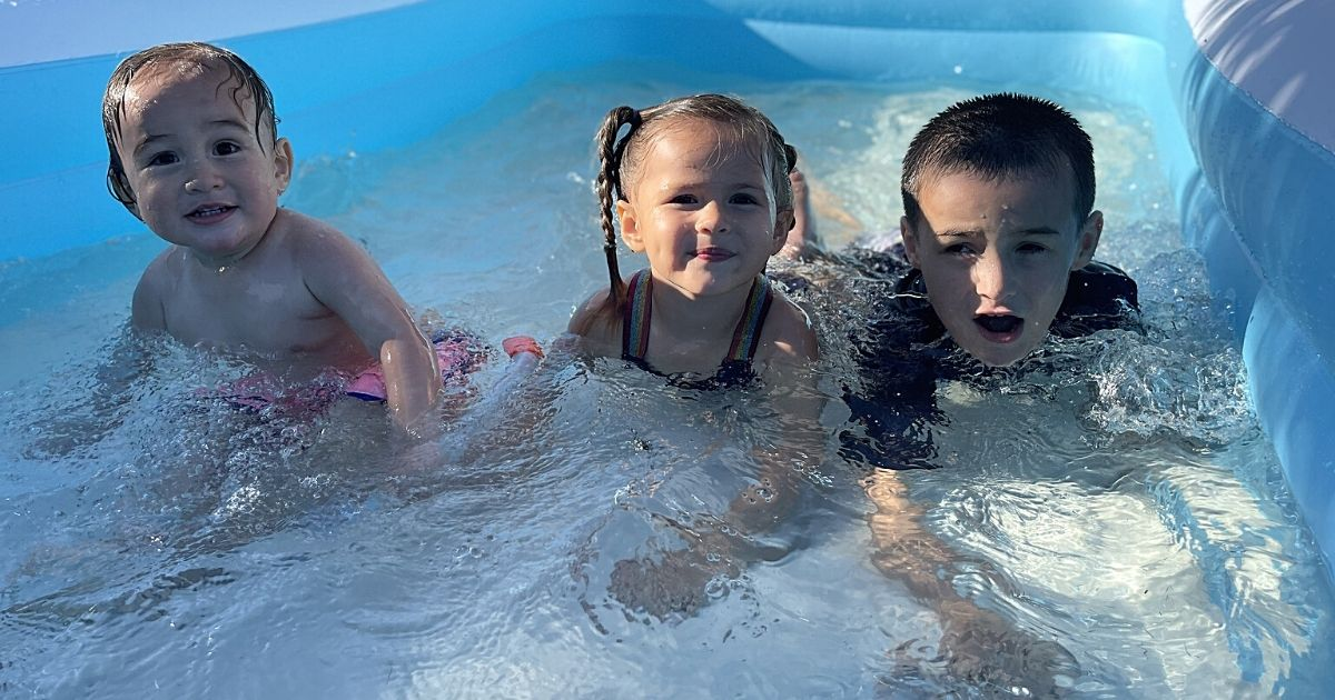 three kids in pool