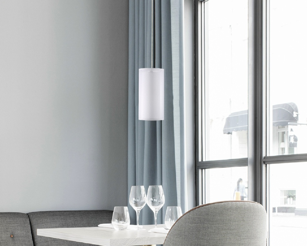 single white pendant light above table