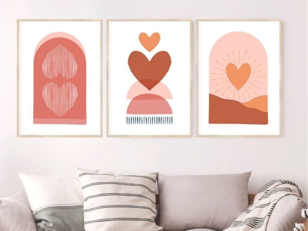 heart art prints framed on wall