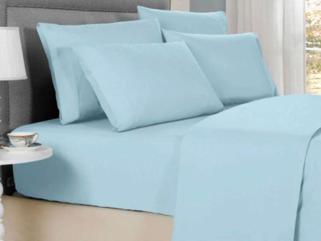aqua sheets on bed