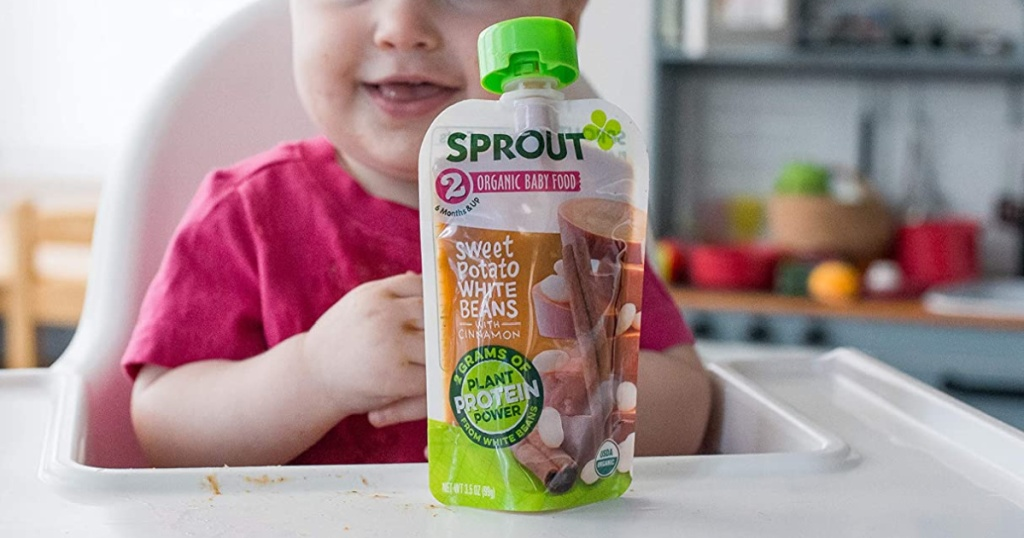 sprout baby food pouch with baby in high chair