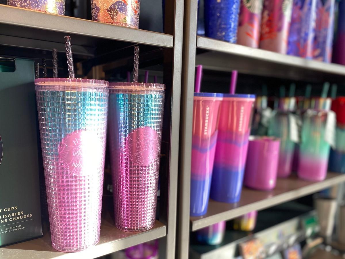 Starbucks reusable tumblers on shelves