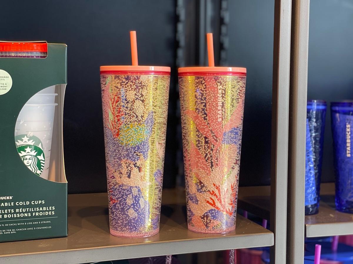 two Starbucks reusable tumblers
