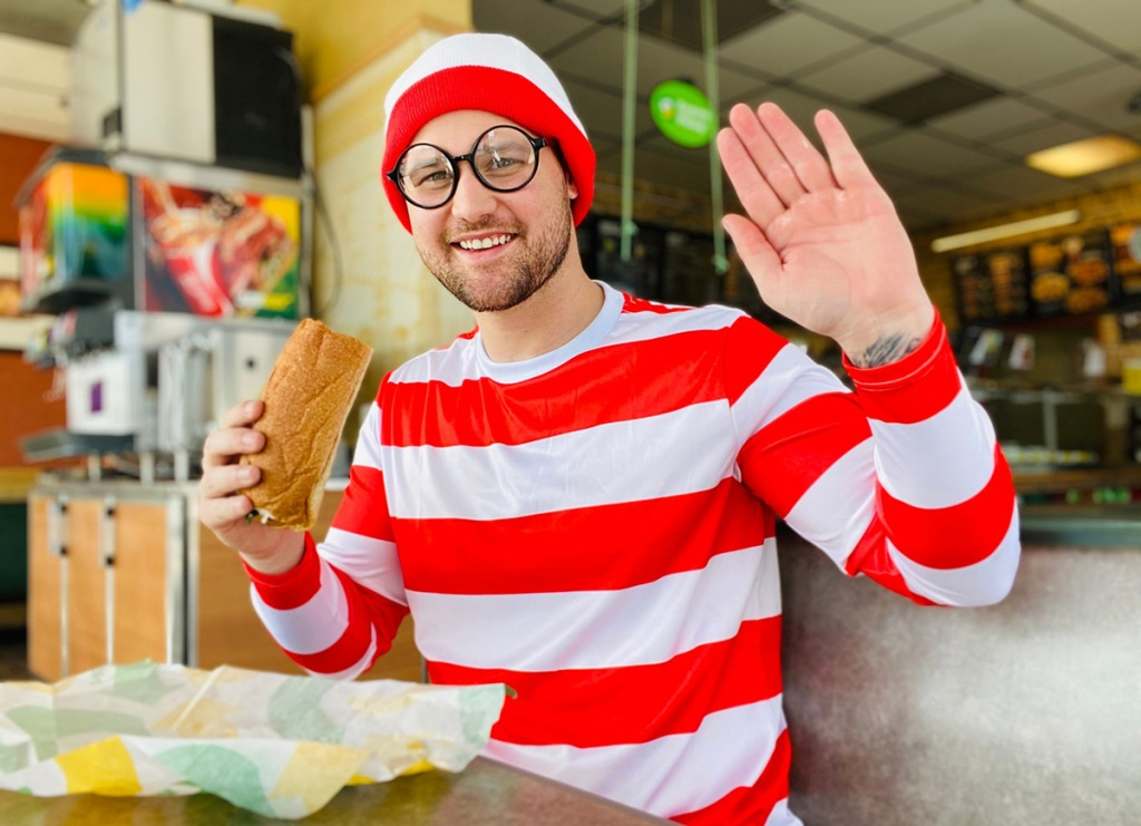 man eating a subway sandwich