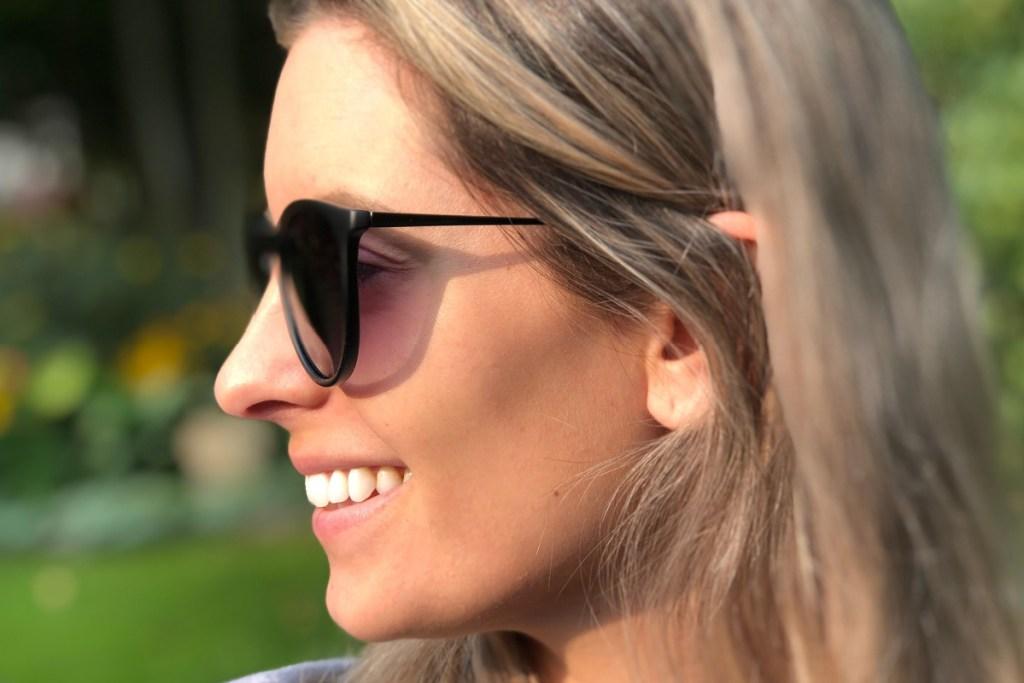 sungait black retro sunglasses on woman facing sideways