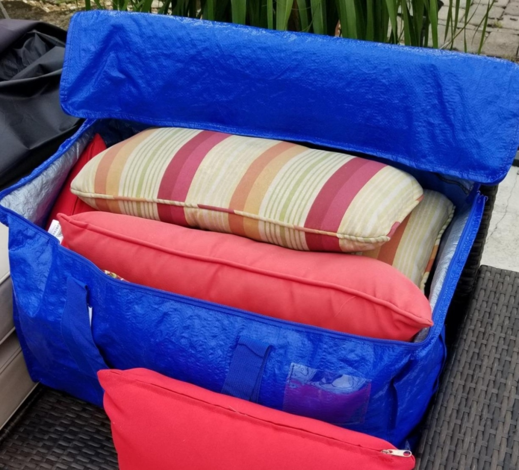 blue storage bag with patio cushions inside