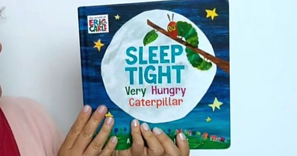 hand holding sleep tight very hungry caterpillar