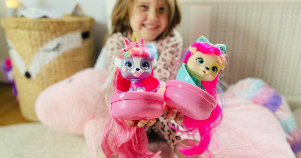 girl smiling holding vip pet dolls