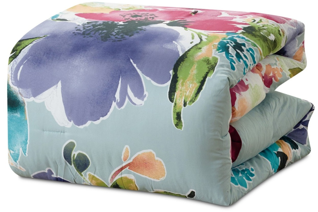 water olor floral comforter folded up