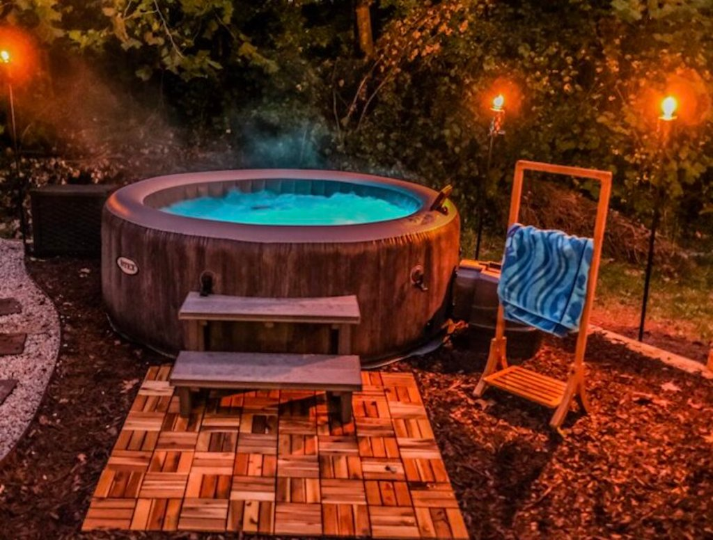 inflatable hot tub outside with string lights