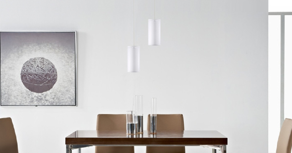 white pendant lights hanging above table