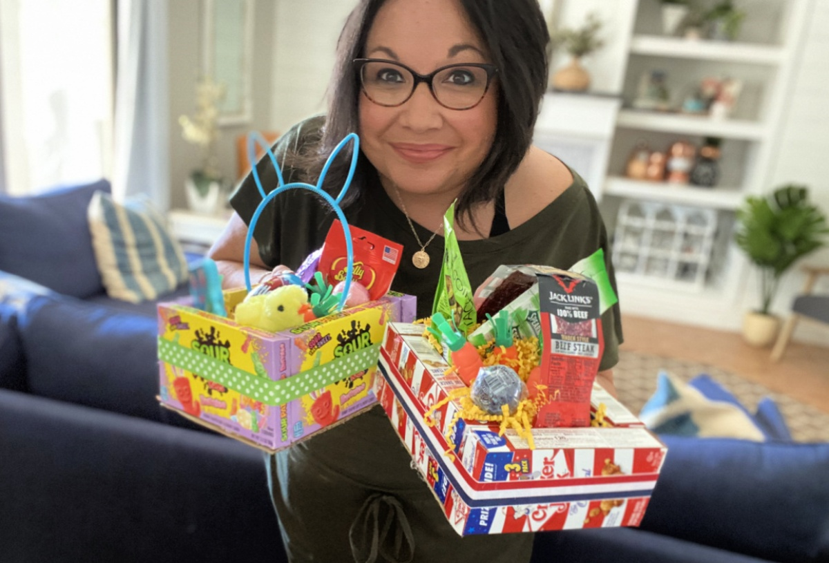 woman holding two edible easter baskets