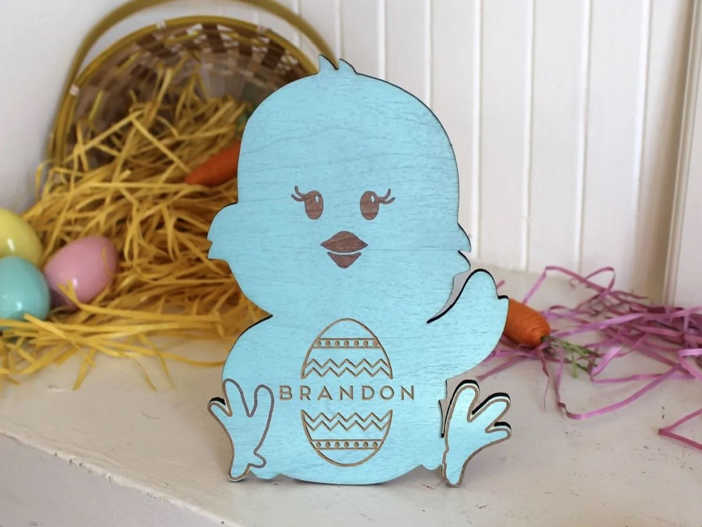 wooden chicken with kids name on it painted blue