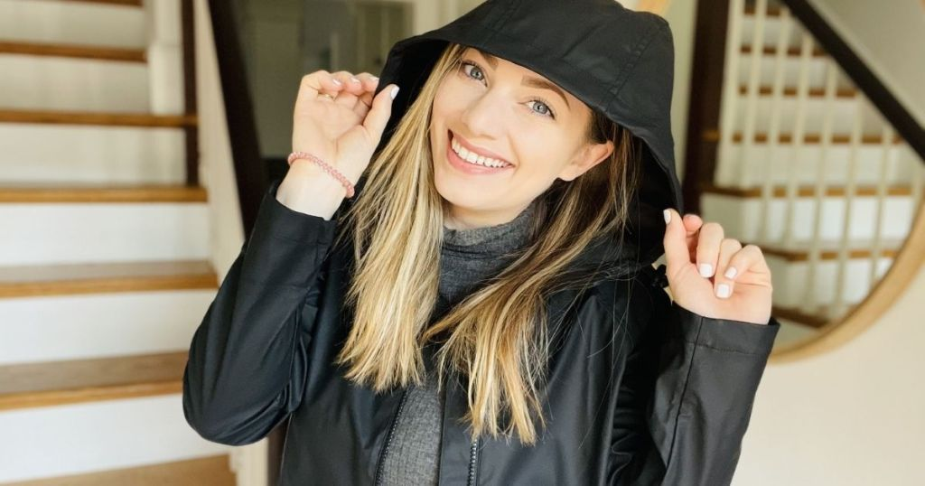 woman wearing a jacket and smiling at the camera