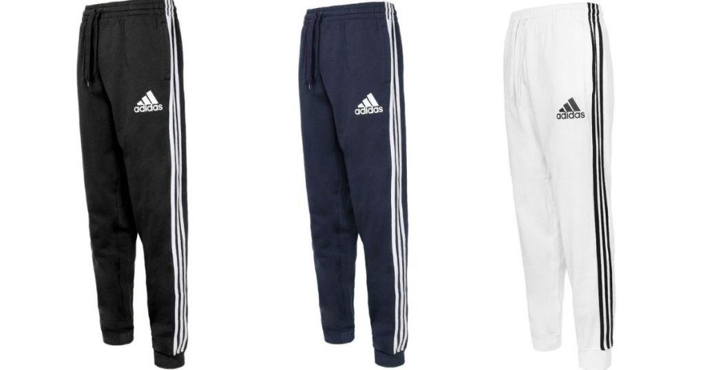 three pairs of adidas pants