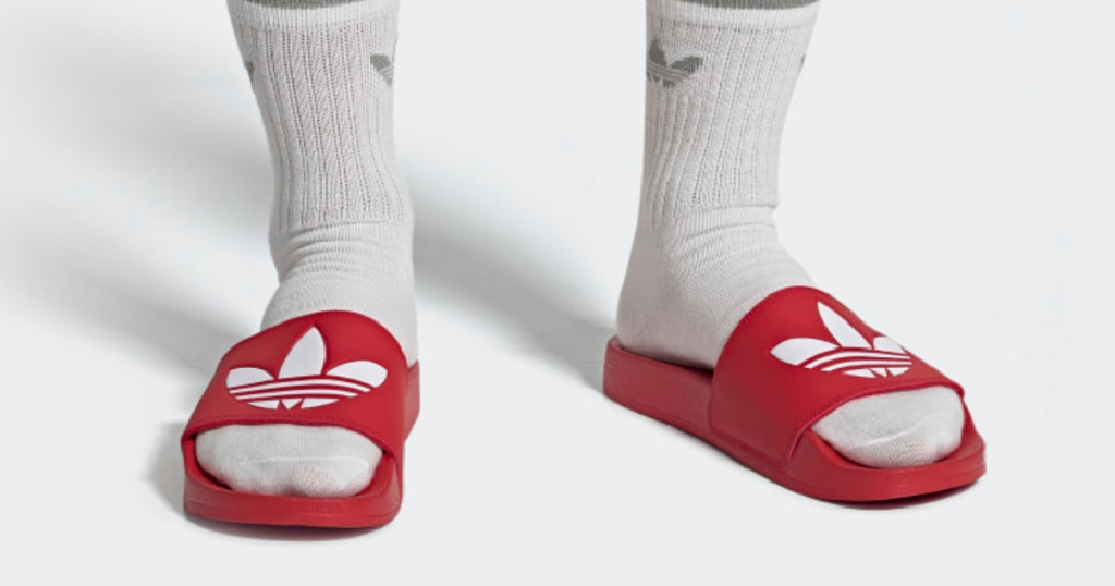 red and white adidas slides