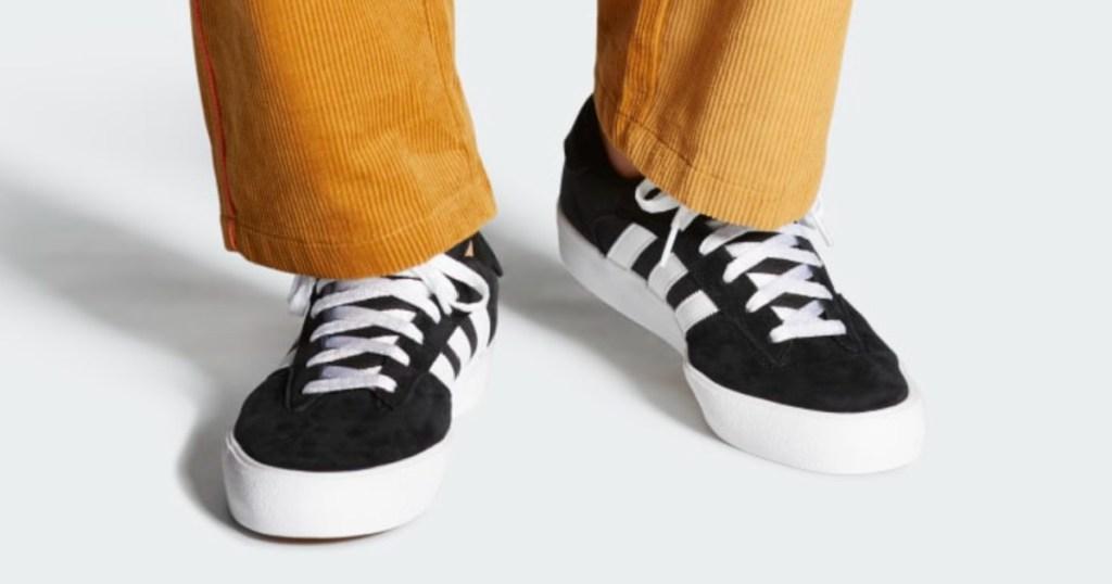man wearing adidas shoes