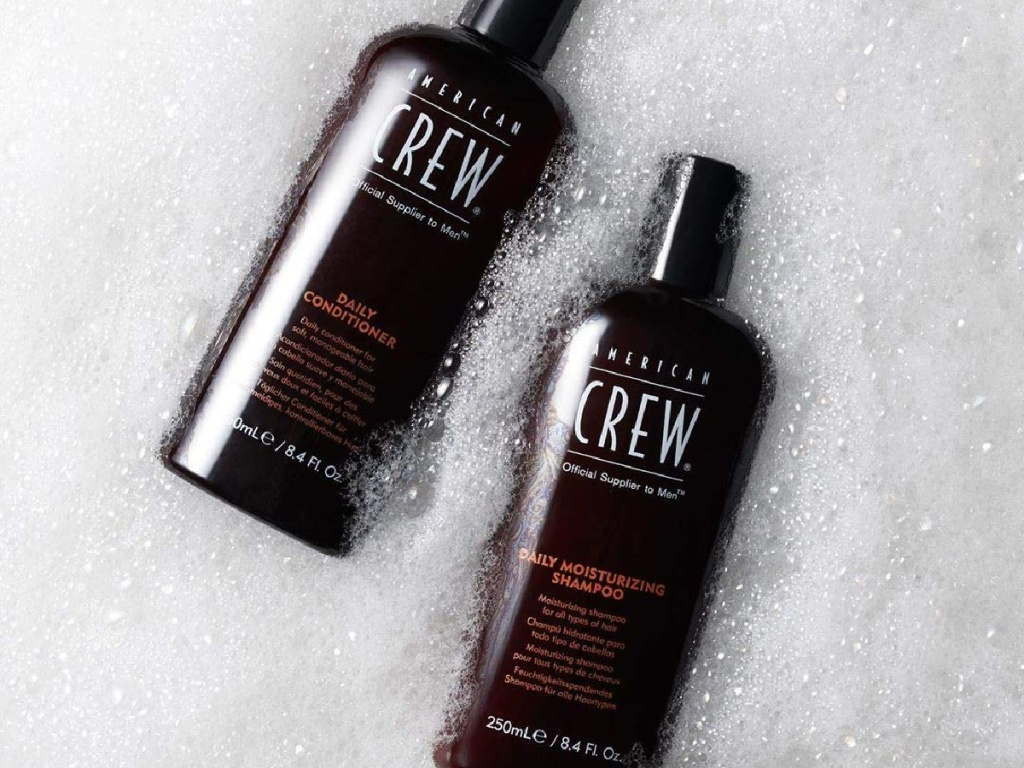 two bottles of shampoo in bubbles