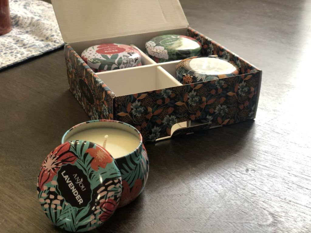 gift box with candle in front of it
