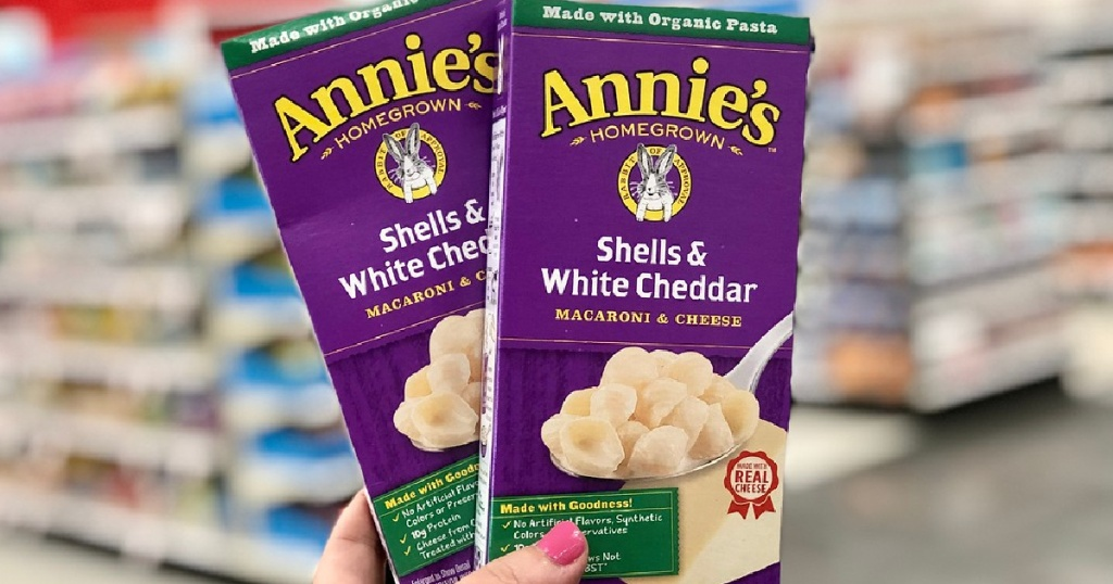 lady holding two boxes of Annie's macaroni & cheese