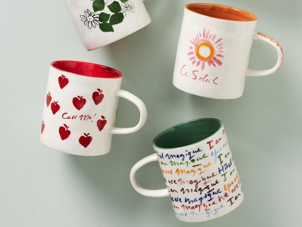 Variety of hand painted mugs