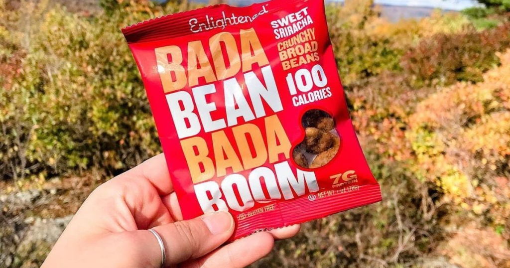 man holding Bada Bean Bada Boom snack bag