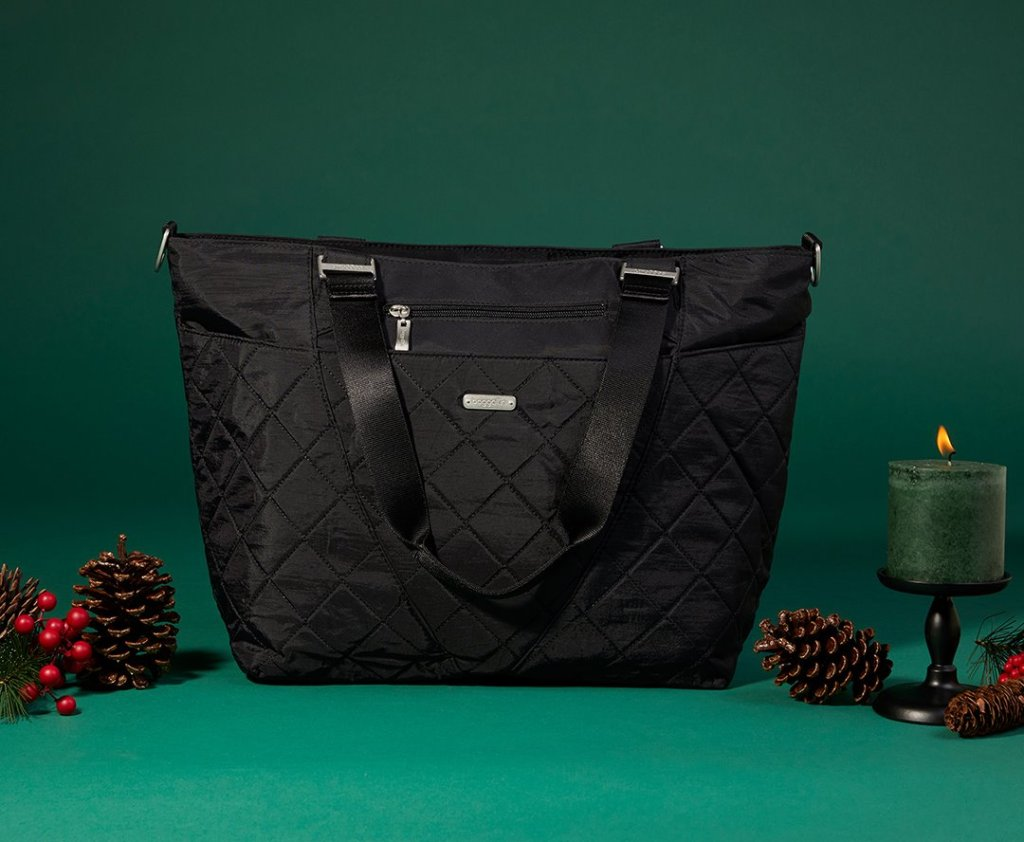 baggallini black bag with green background