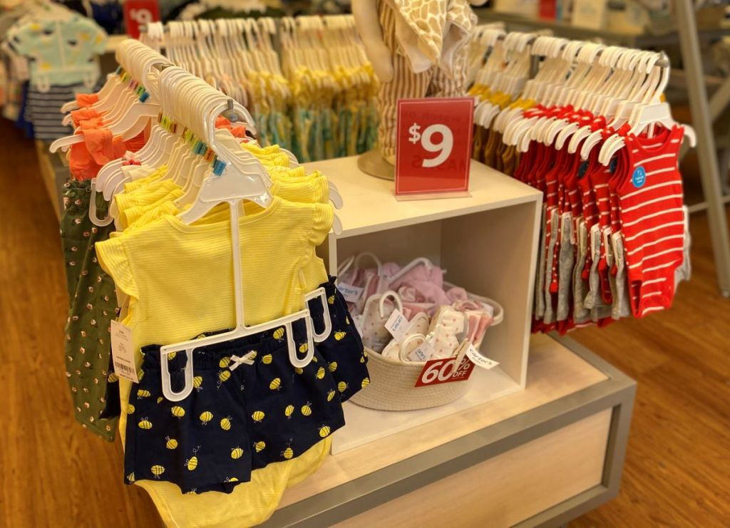 baby outfits on hangers at Carter's