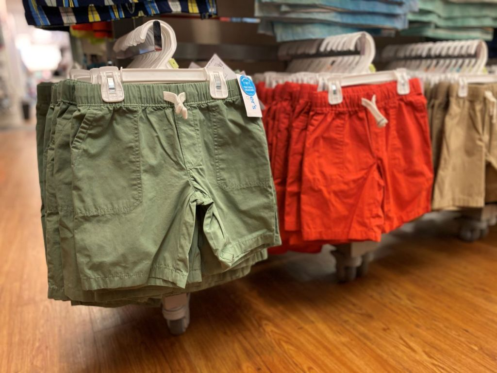 shorts on hangers at a store