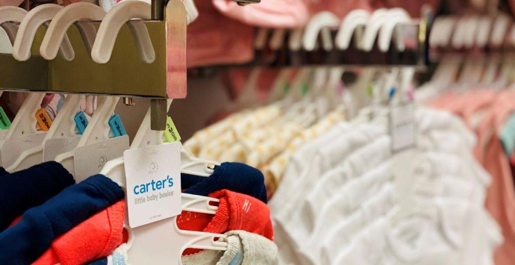 Carter's bodysuits on hangers