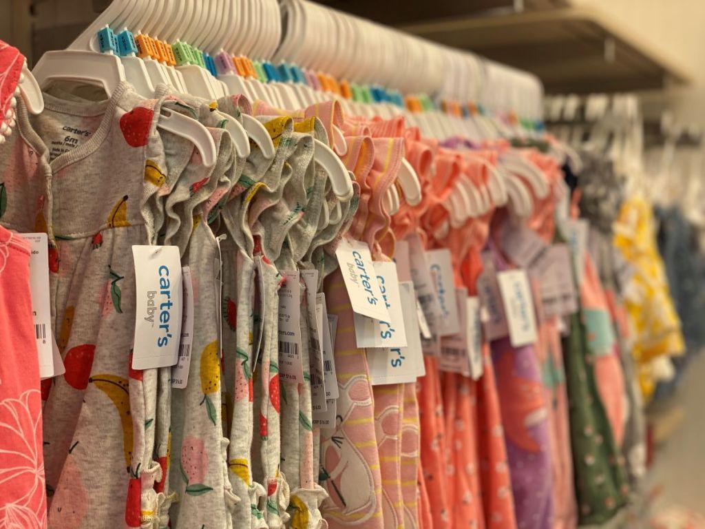 row of Carter's rompers on hangers