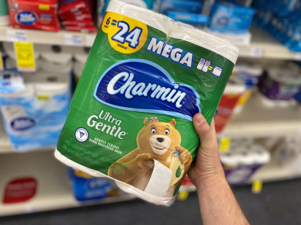 hand holding a package of Charmin Ultra Toilet Paper