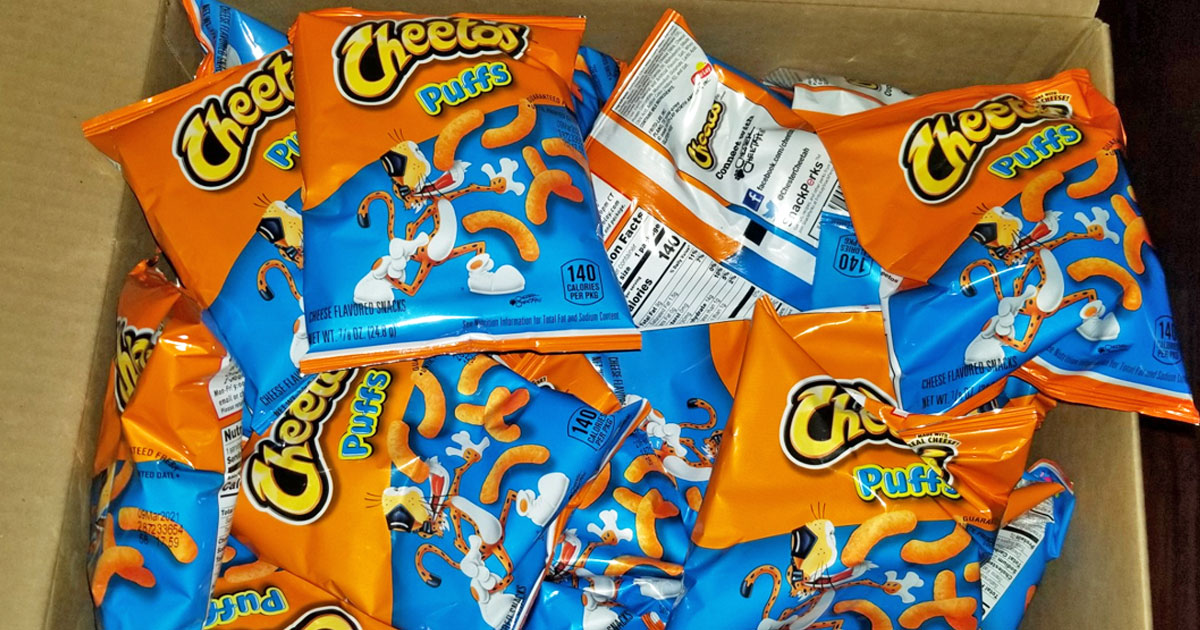 orange and blue bags of cheetos puffs in a cardboard box