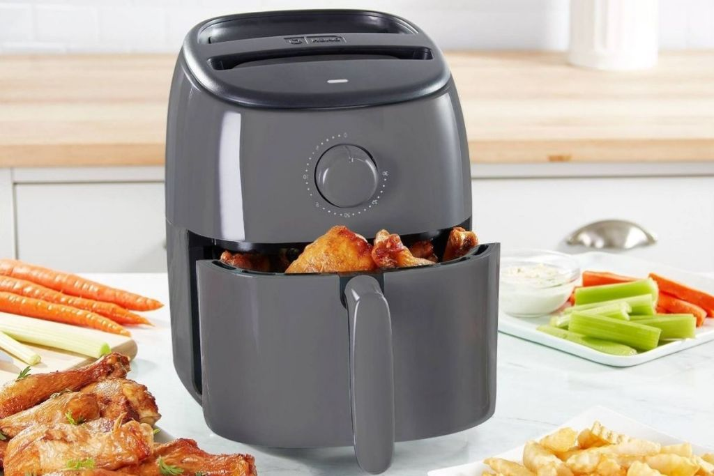 Dash 2.6 qt Air Fryer on counter with food in gray