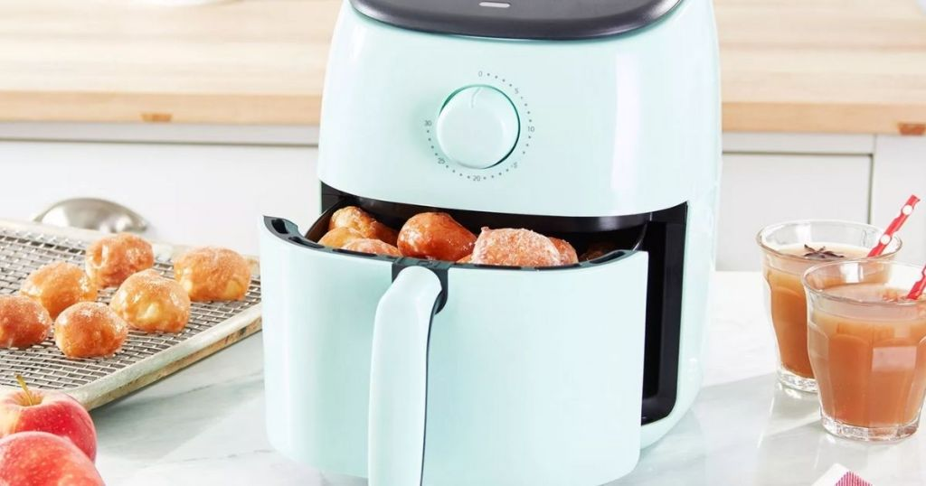 Dash Tasti-Crisp Express 2.6-qt Air Fryer on counter with food