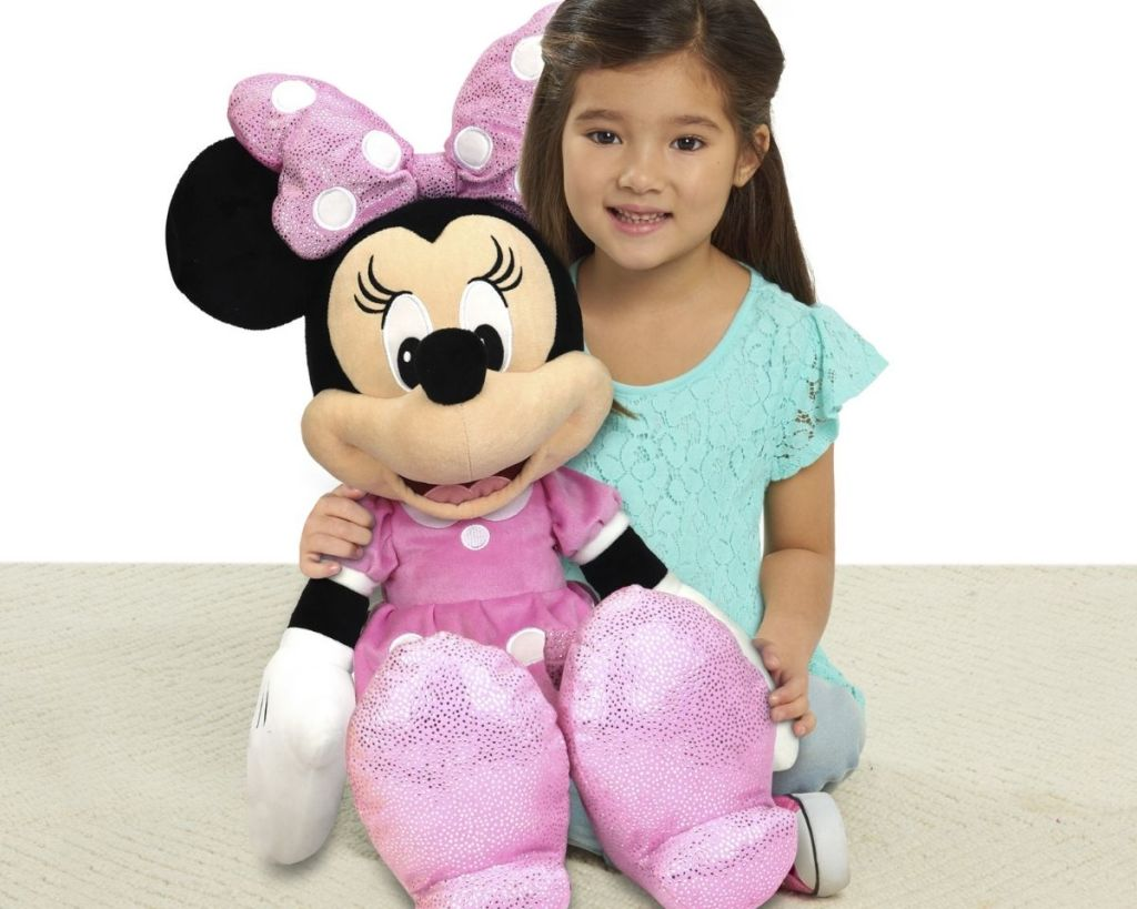 girl with Disney Junior Plush Minnie Mouse