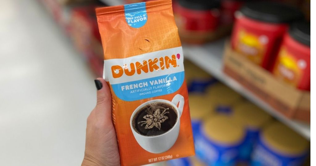 hand holding a bag of Dunkin French Vanilla