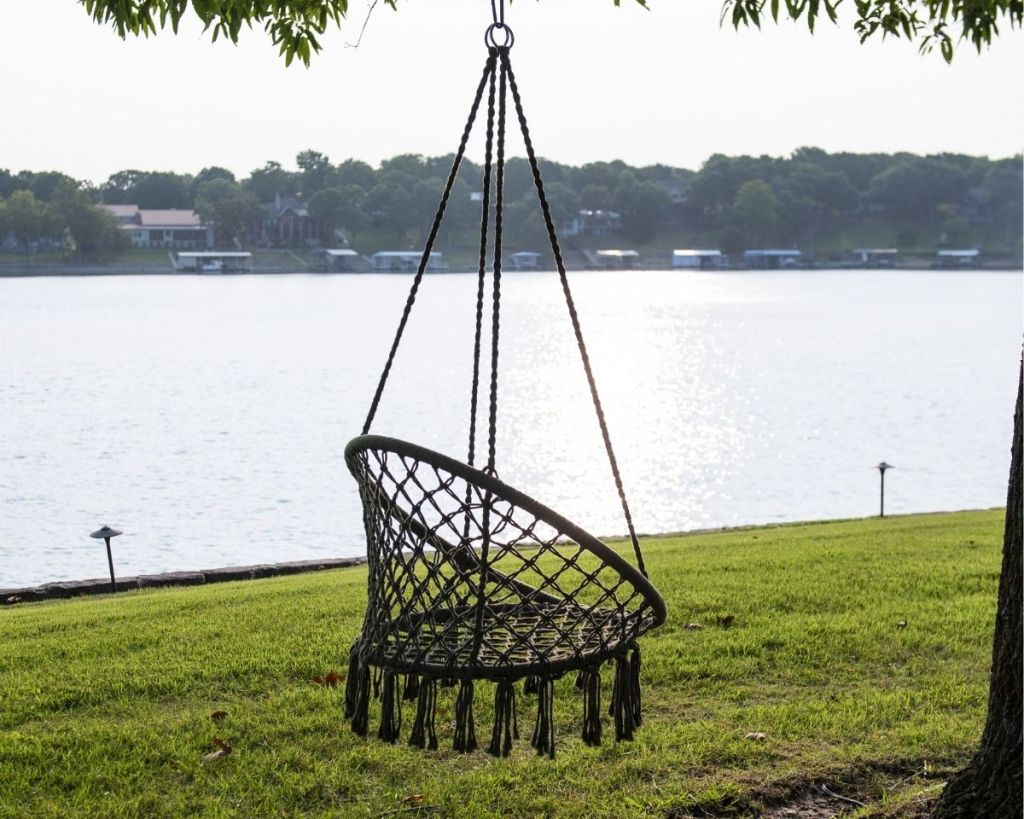 Equip Boho Macrame Hanging Chair in a tree by water