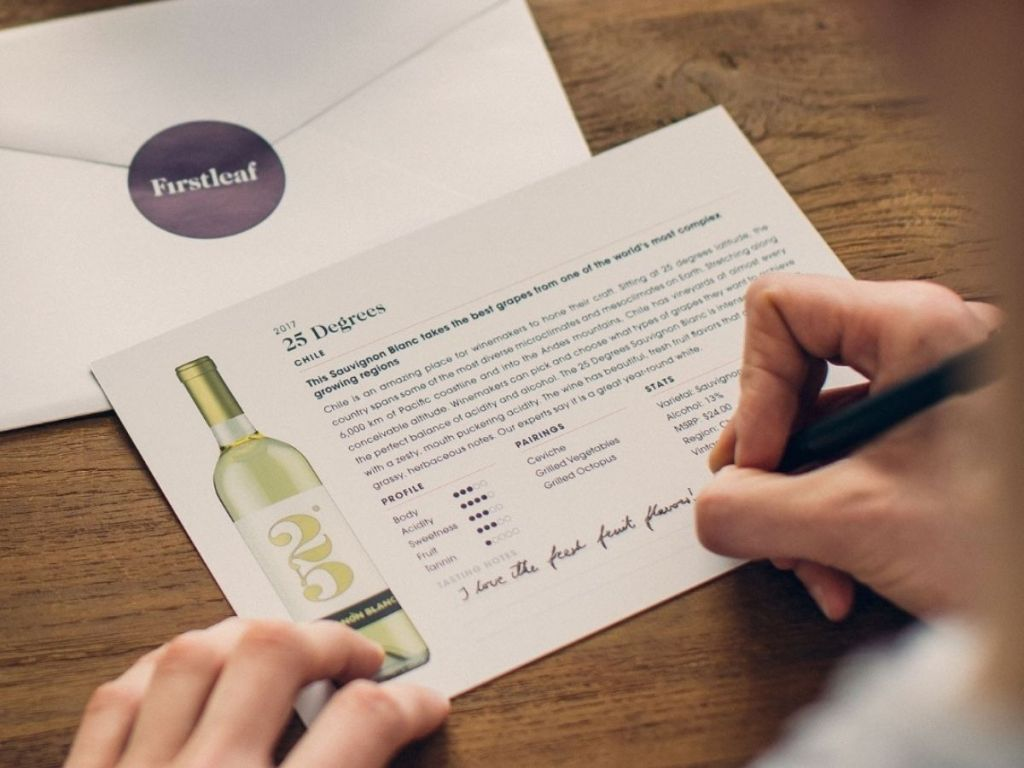 woman rating wines on custom card