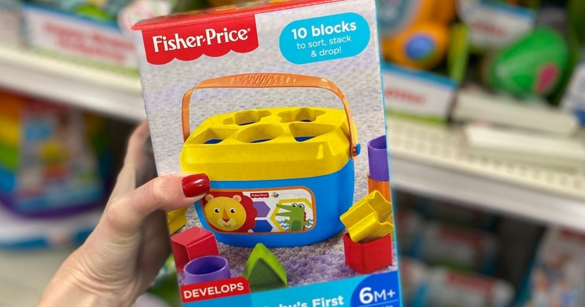 hand holding Fisher-Price Baby's First Blocks in store