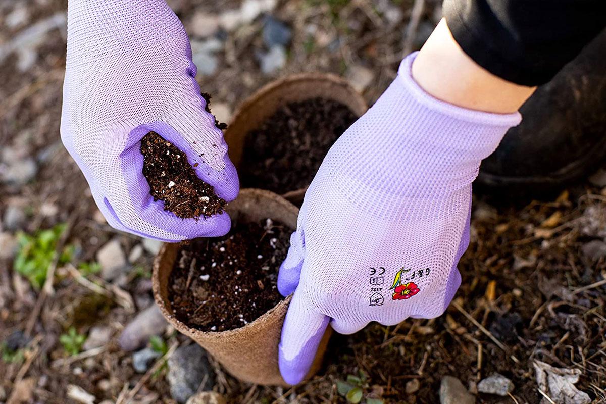 person wearing purple gardening gloves