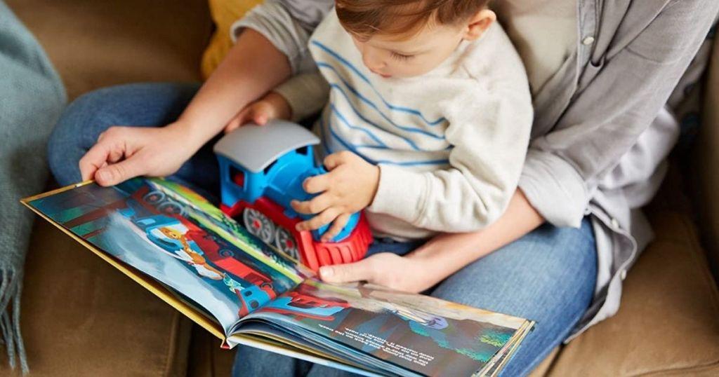 boy holding a toy train