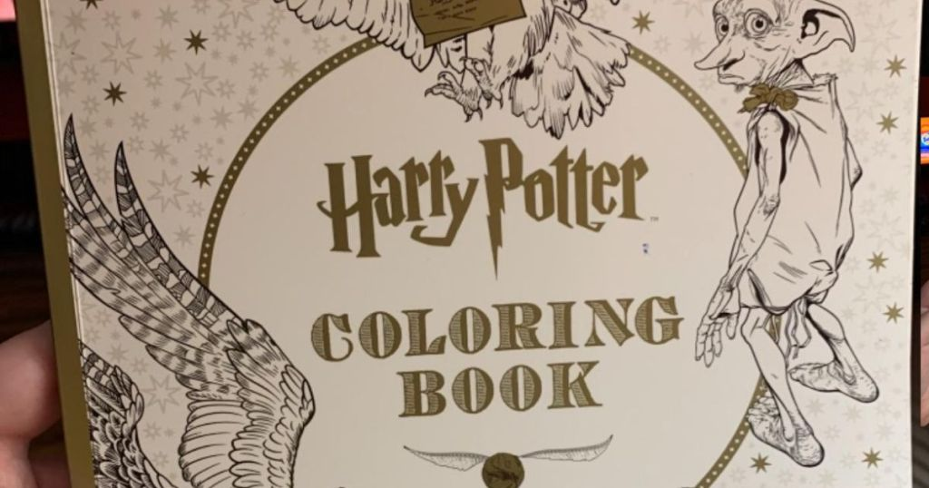 hand holding Harry Potter Coloring Book