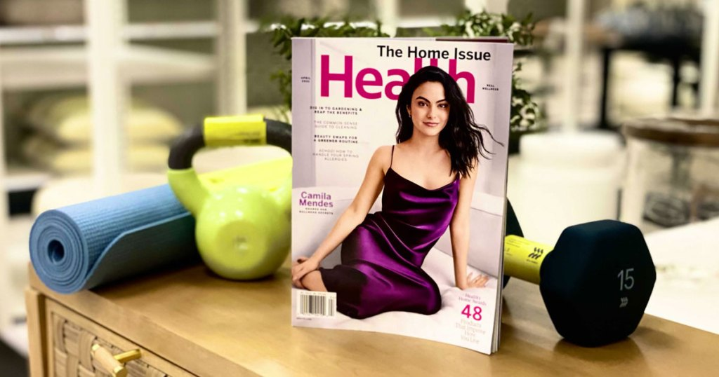 issue of health magazine next to yoga mat and hand weights