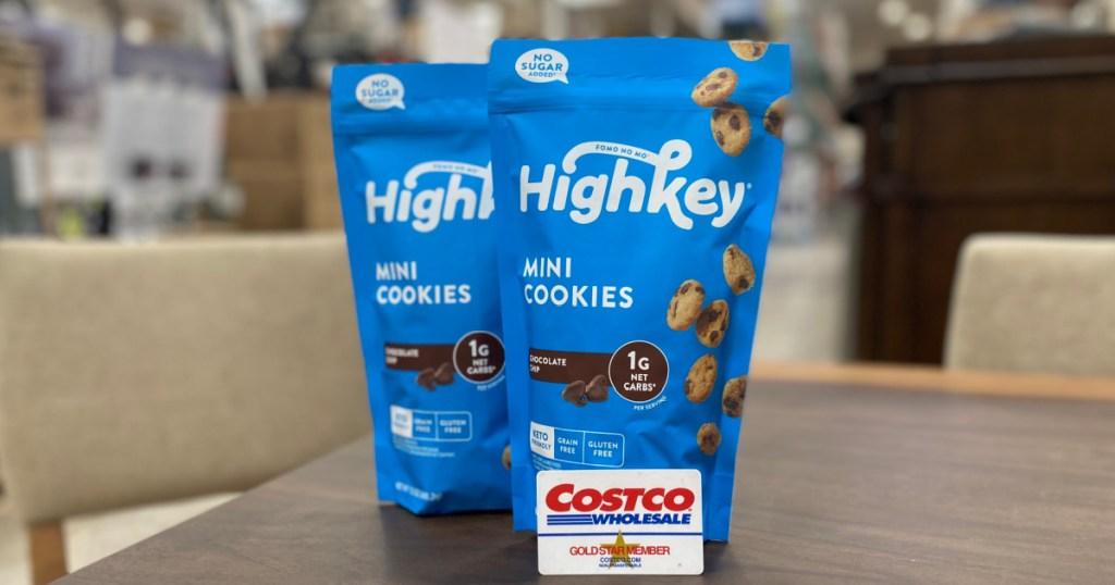 Bags of Highkey mini cookies near a Costco card